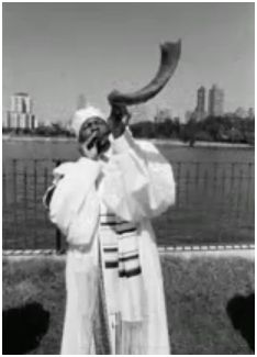 a member of the Commandments Keepers, from NYC, blowing the Shofar.