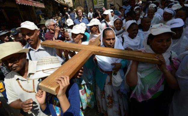 "Tewahido Orthodox-Christians carrying the Cross on Siqlet(ስቅለት) aka ""Good Friday"" in Jerusalem."