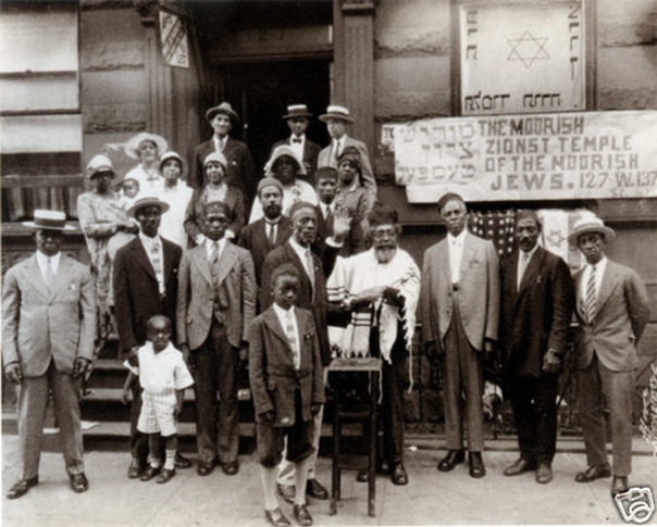 NOTICE: the sign behind the Commandment Keepers of Harlem, NY led by Rabbi Wentworth A. Matthew, recognized the importance of the knowledge historical reference (HEBREWS ARE MOORS, TOO)
